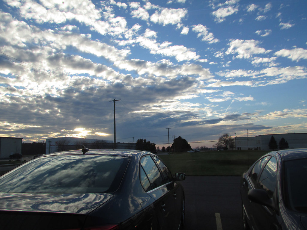 Beautiful sun set with clouds over a parking lot