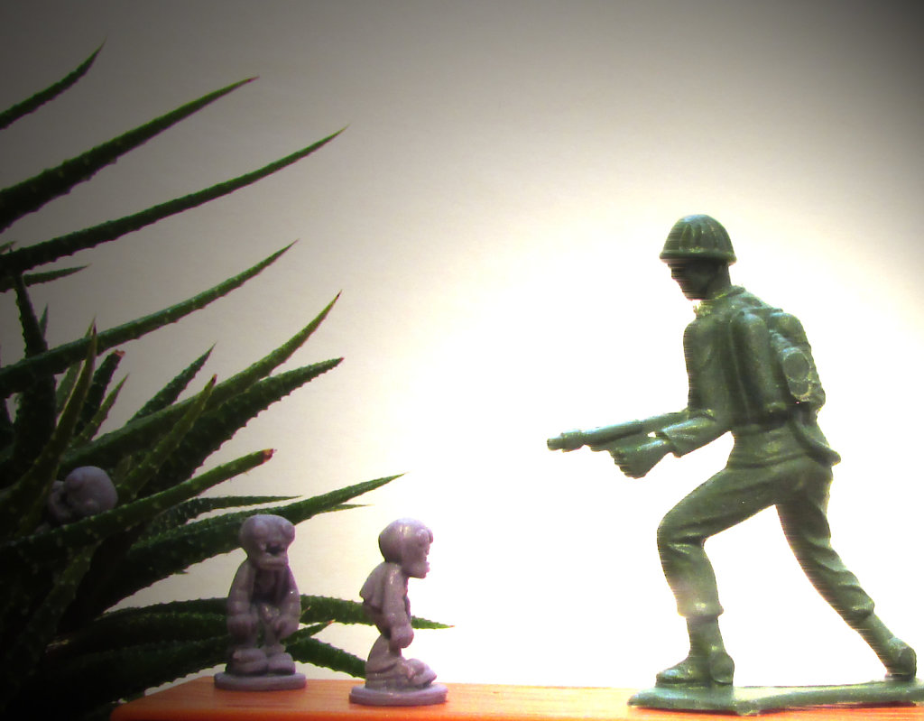 Toy soldier battling little zombie men