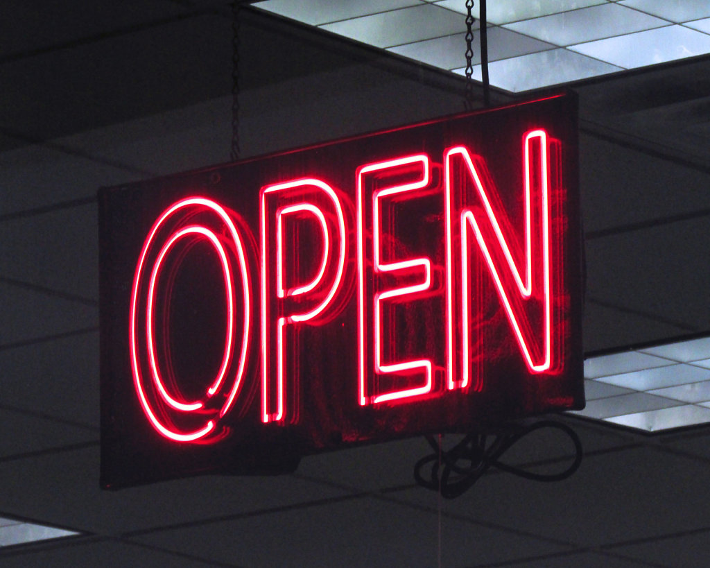 Neon red open for business sign