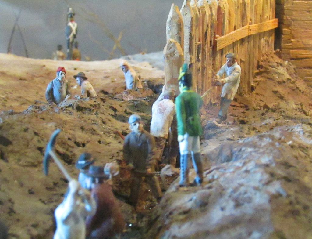 Toy figures reenact the building of a trench
