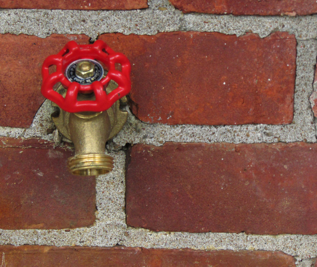 Faucet in brick wall image