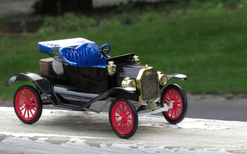 Small toy car model with red spokes