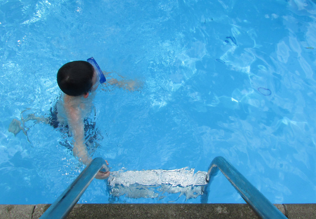 top view of kid swimming