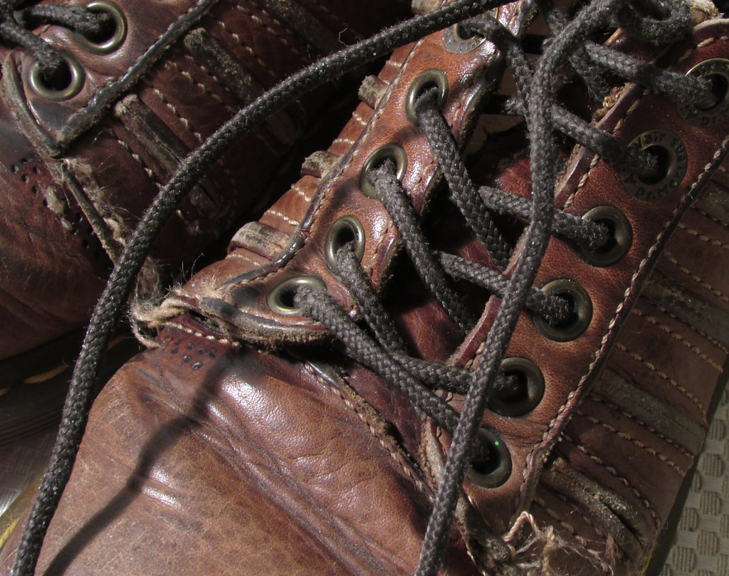 old worn work boots horizontal