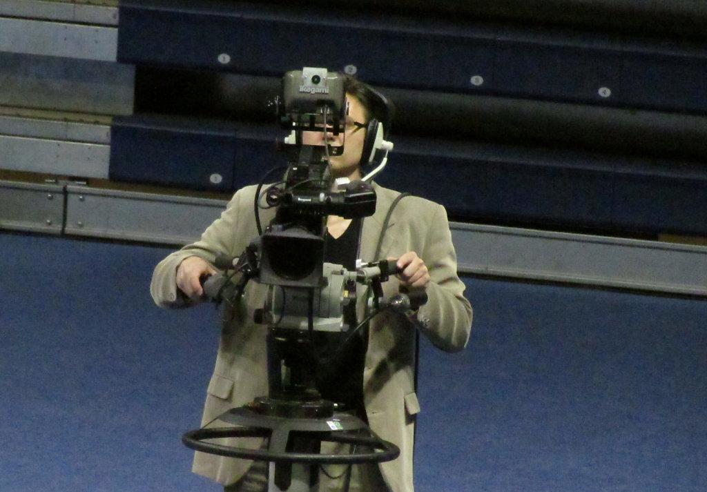Camera man and camera