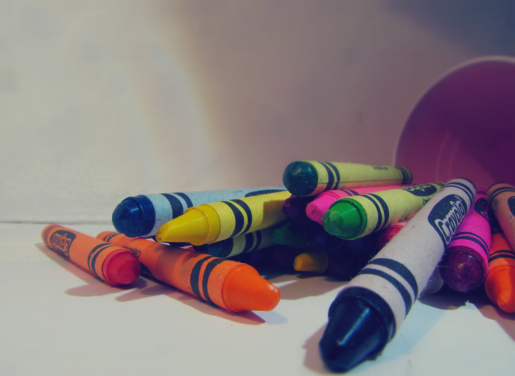 crayons on top of table
