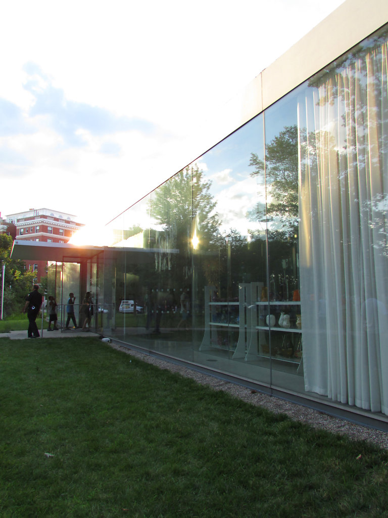 Glass building with line of people